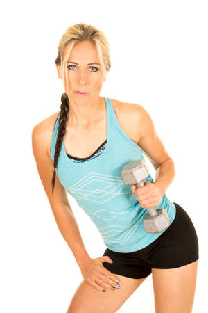 tricep: a woman in her fitness clothing holding on to a weight, working out her tricep. Stock Photo