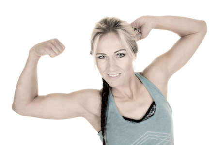 flexed: A woman in her fitness clothes, with her arms flexed.