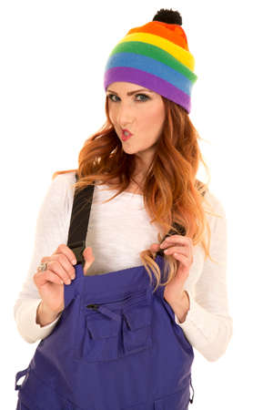 coveralls: A woman in her colorful beanie and ski coveralls. Stock Photo
