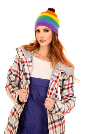 beanie: A woman in her winter coat, beanie and coveralls ready to ski. Stock Photo