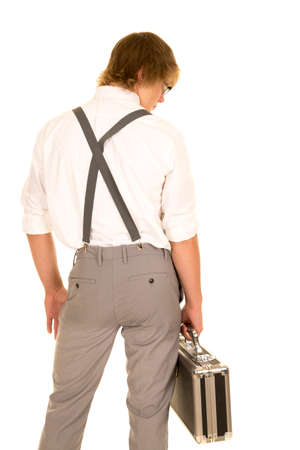 slacks: a young man in his business slacks holding on to his case.