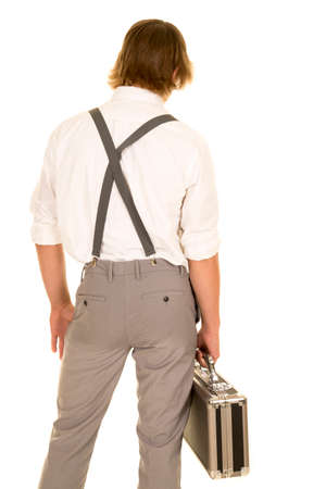 dressy: a young man in his dressy clothing holding on to his case. Stock Photo