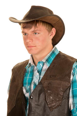 western clothing: A young man in his western vest and hat, with a serious expression on his face.