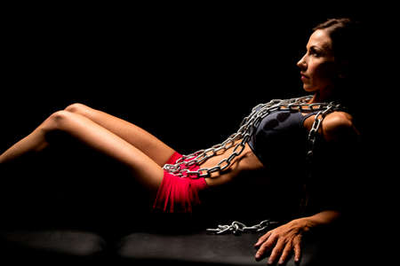sports attire: A woman with chains around her neck highlighted in sports attire. Stock Photo