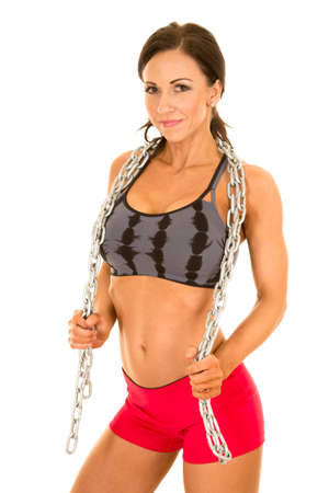 female sexy chains: A woman in a black and gray sports bra with a chain around her neck. Stock Photo