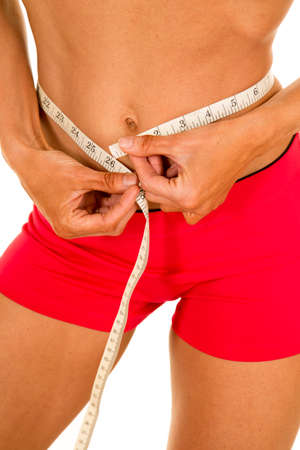 female sexy chains: a woman with a measuring tape measuring her waist.