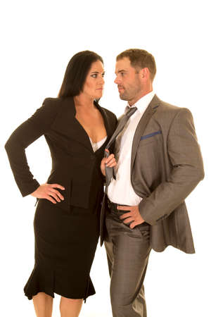 wanting: a woman pulling on her partners tie wanting him. Stock Photo