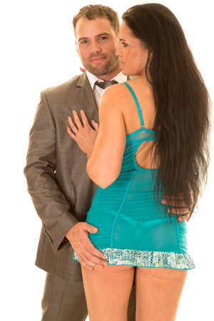 a man in his business suit holding on to his womans butt.
