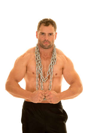 flexed: a man flexing his muscles with a chain around his body.