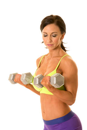 female sexy chains: A woman in her fitness clothing working out her arms with weights. Stock Photo