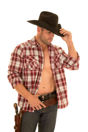 A cowboy in his plaid shirt open and showing off his chest, with his pistol on his hip.