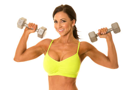 female sexy chains: a woman with a smile on her face, working out with weights. Stock Photo
