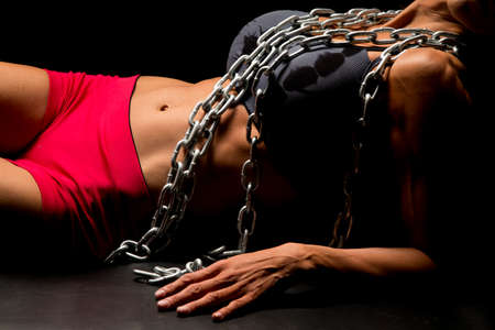 female sexy chains: The body of a woman with chains highlighted. Stock Photo