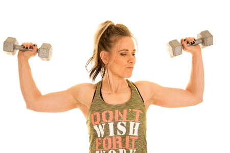 a woman doing shoulder presses with weights, getting stronger.