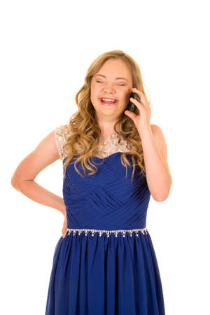 a woman with down syndrome laughing while talking on her phone, laughing.