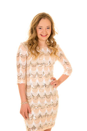 challenged: A woman with down syndrome in her dress with her hands on her hip.