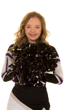 adult cheerleader: a cheerleader who has down syndrome with a big smile on her face. Stock Photo