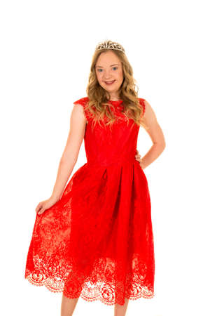 challenged: A woman with down syndrome in her lace red dress with a smile on her face.