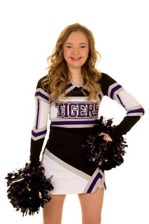 Een cheerleader met down syndroom lachend naar de camera. Stockfoto