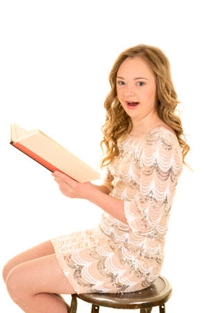 challenged: A woman with down syndrome, holding onto a book, with a shocked expression.