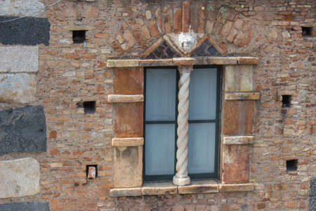 Italy: old window and rocky wall photo