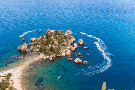 bella: Aerial view of island and Isola Bella beach and blue ocean water in Taormina, Sicily, Italy Stock Photo