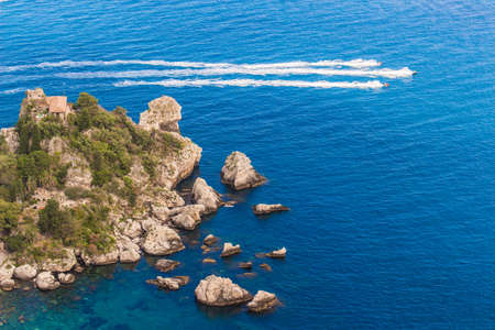 isola: Aerial view of island and Isola Bella beach and blue ocean water in Taormina, Sicily, Italy Stock Photo