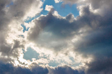 cloudscapes: Dark clouds cover the blu sky