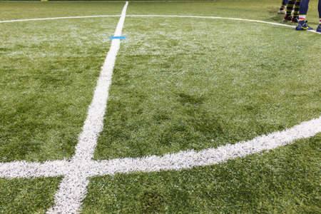 finishing school: In the middle of football field