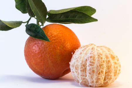 peeled: Tangerine and peeled tangerine on white background.