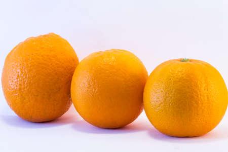 trio: Trio oranges on white background Stock Photo