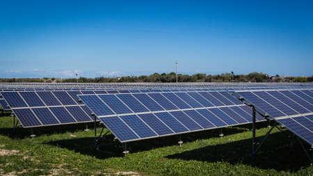 sun energy: Solar panel produces green, enviromentaly friendly energy from the sun. Stock Photo