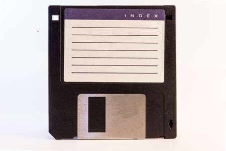 iconography: Detail of an old black floppy disk with space for tetx