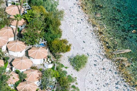 qui: Aeral view of sicilian beach with peopAeral view of sicilian beach with people, umbrellas and wonderful sea.