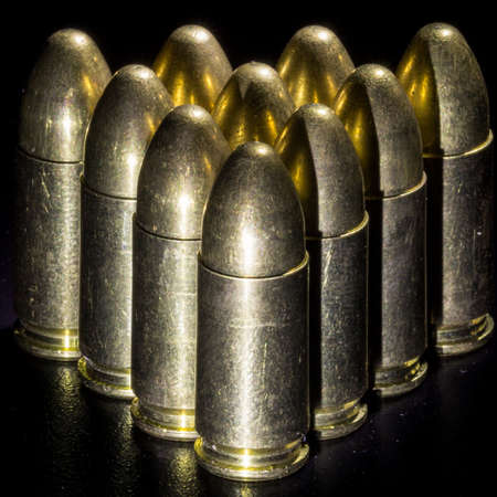 The bullets on black background Stock Photo