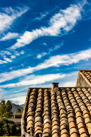 cloude: The ancient roof on a blue sky with clouds streaked