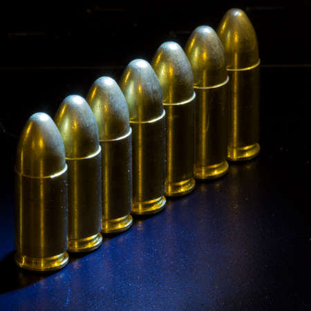 The bullets bullets lined up on black background