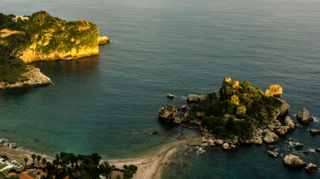 ionian: Aerial view of island and Isola Bella beach and blue ocean water in Taormina, Sicily, Italy Stock Photo