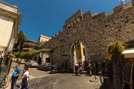 24 month old: TAORMINA ITALY - MAY 07 2017: Ancient Roman passage guarded by soldiers awaiting for 2017 G7 Summit.