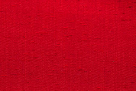 Rustic canvas fabric texture in red color. Stock Photo