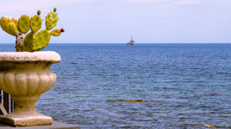 Military ship founding in the blue Mediterranean sea Stock Photo