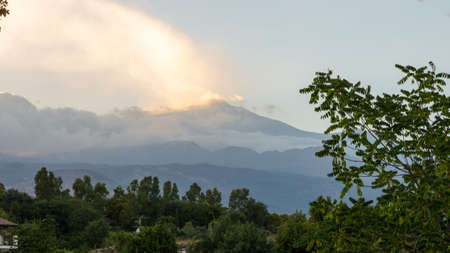 View of volcano Etna from a small Sicilian village at sunset