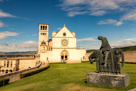 St. Francis of Assisi Church with the statue of St. Francis on a horse in the foreground. St. Francis is the patron saint of Italy. The bell tower can be seen from miles away. Stock Photo