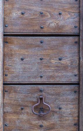 Close up of rustic old door in Spoleto, Italy. Imagens