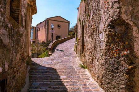 View of a small Sicilian village. Ancient stone road Stock Photo