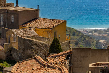 View of a small Sicilian village. With the sea in the background