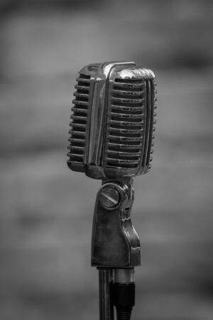 Upright mono black and white photograph of a 1940s era microphone photo