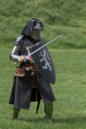 pageant: English knight in armour with sword
