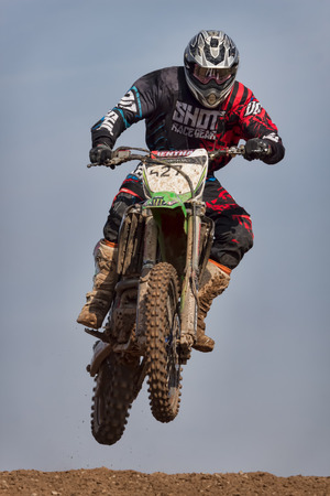 scrambling: Motocross action from rider Michael Aston tackles a jump at an AMCA event 22 March 2015 in Norley, Cheshire, United Kingdom
