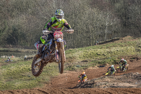 scrambling: Motocross action from rider James Chambers tackles a jump at an AMCA event, 22 March 2015 in Norley, Cheshire, United Kingdom Editorial